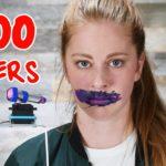 Simone Giertz, lässt sich von einem Roboter 1000 Schichten Lippenstift auftragen